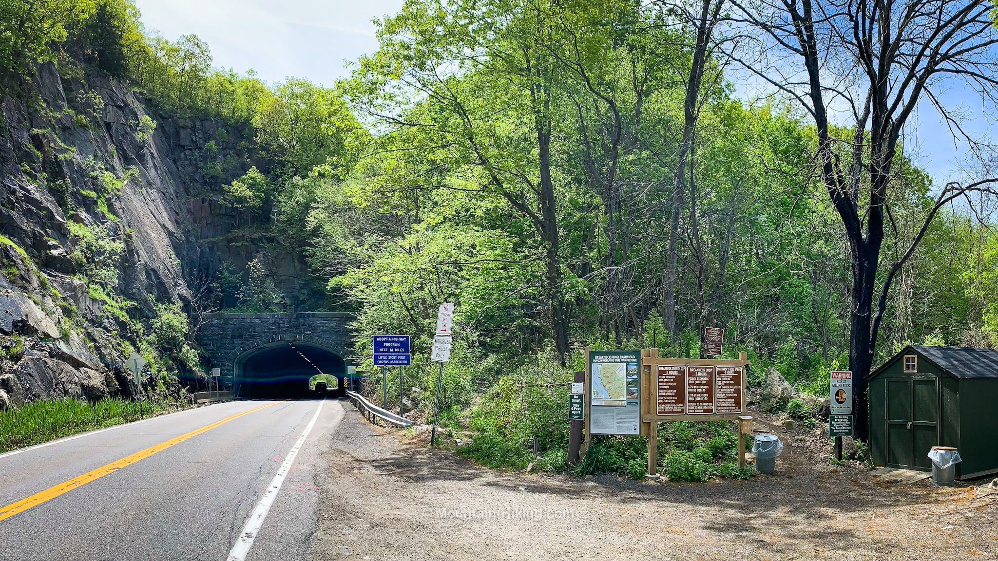 Breakneck Ridge trailhead next to road and tunnel