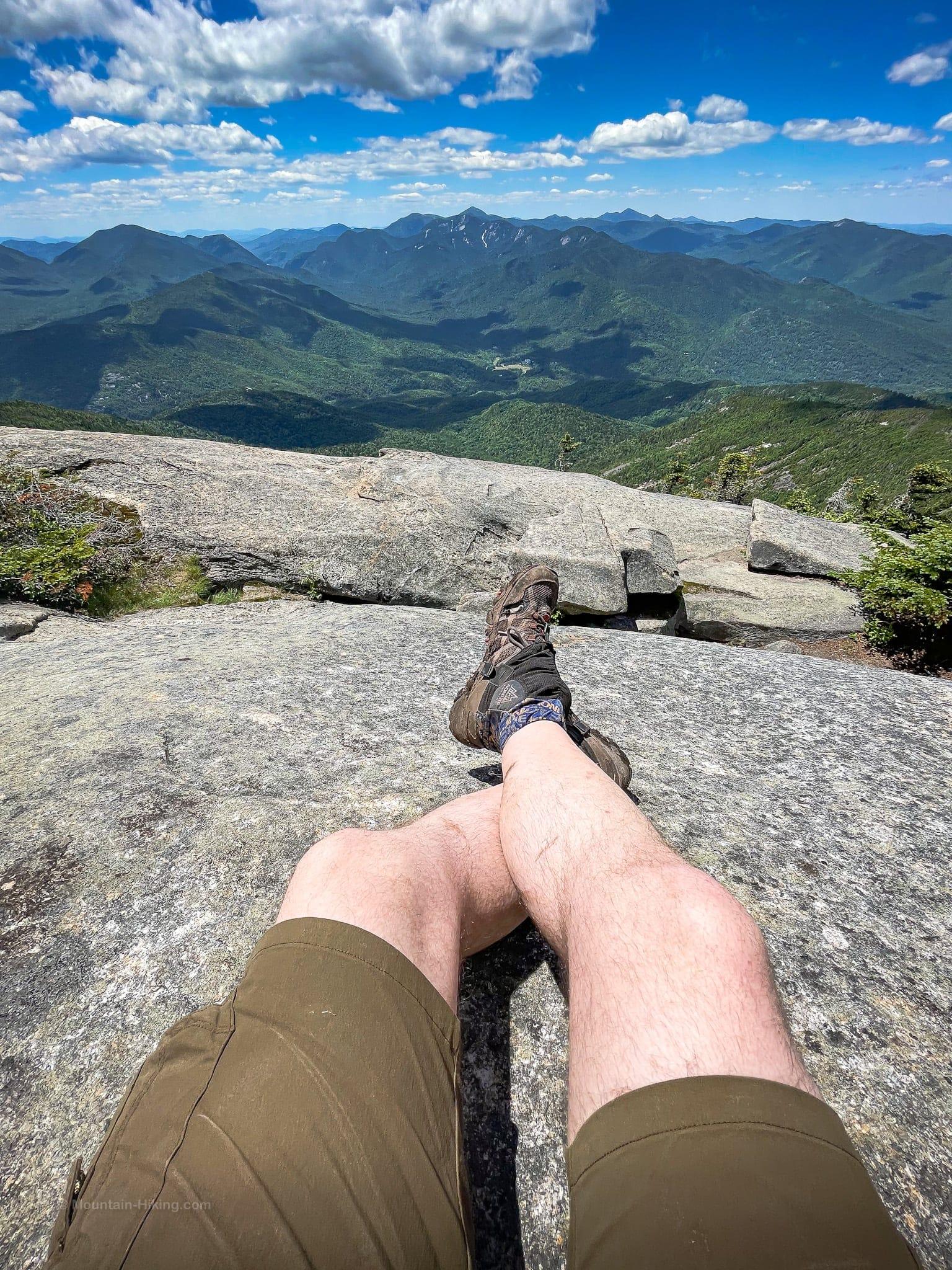 hiking shorts on hiker on mountain summit