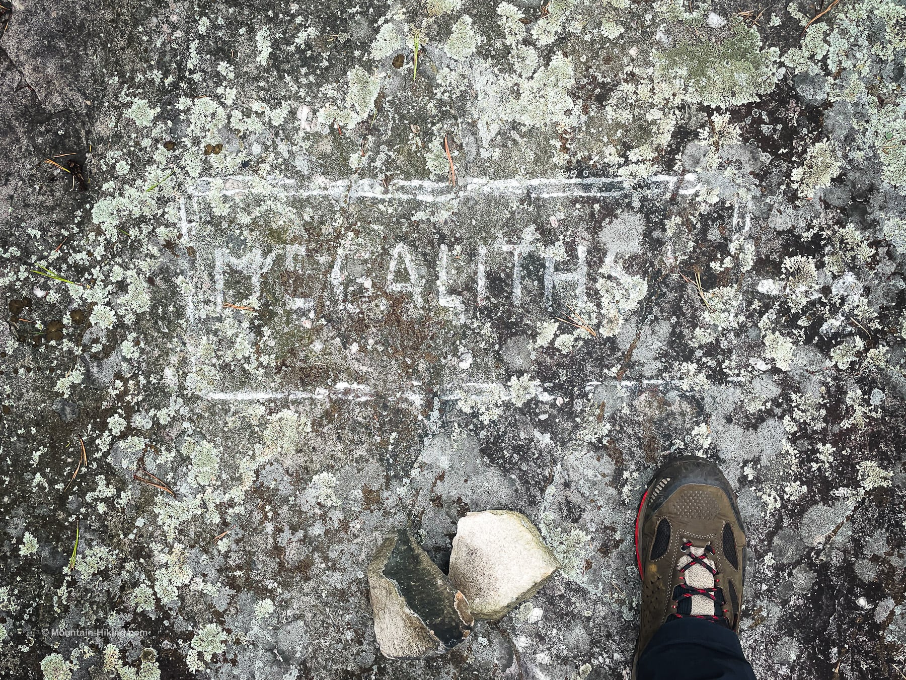 words scratched on bare rock on schunemunk mountain
