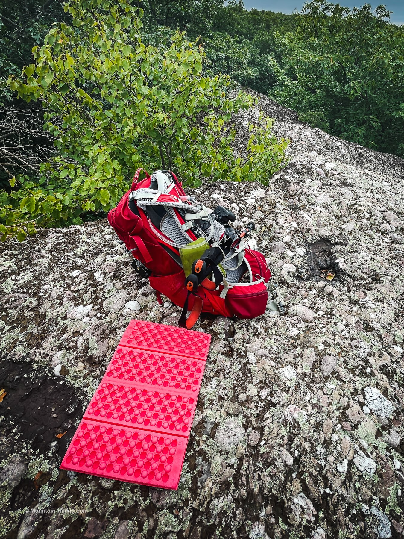 pink sit pad on bare conglomerate rock