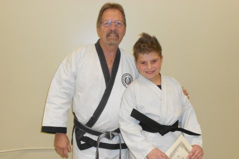 Grand Master Rankin with new black belt Daniel Fess