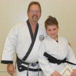 Grand Master Rankin with new black belt Daniel Fess