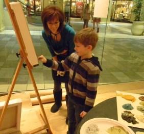 Vicki Denaburg engaging a child