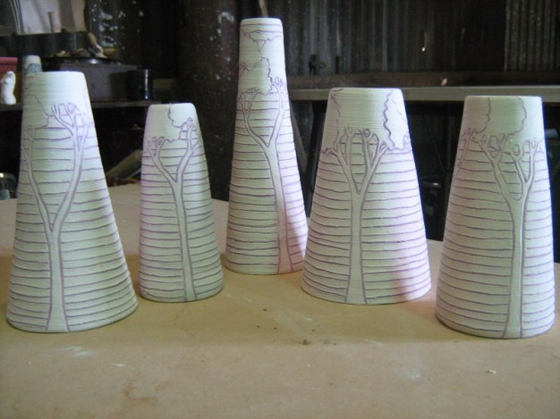 unfired engraved pots