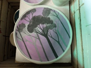unfired forest plate in kiln