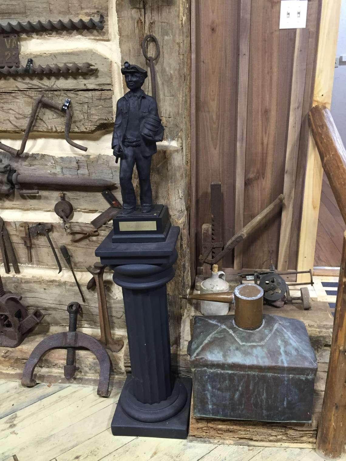 "Statue Made of Coal and Moonshine ""Thumping Keg"""