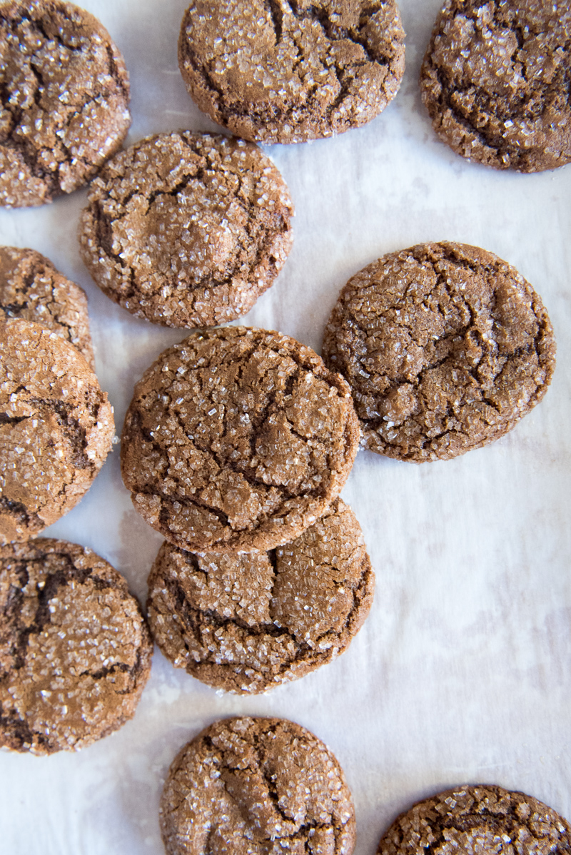 A baking sheet with homemade molasses cookies. www.mountainmamacooks.com