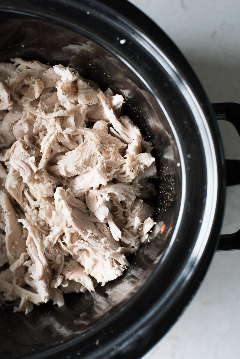 Cooking chicken in the slow cooker. An easy recipe for shredded chicken breasts that can be used in so many other recipes. www.mountainmamacooks.com