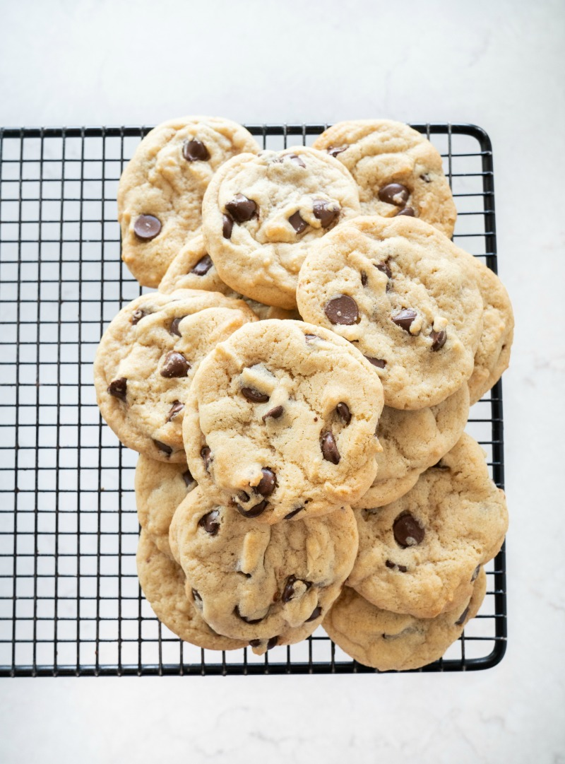 A cooling tray loaded with puffy chocolate chip cookies. www.mountainmamacooks.com