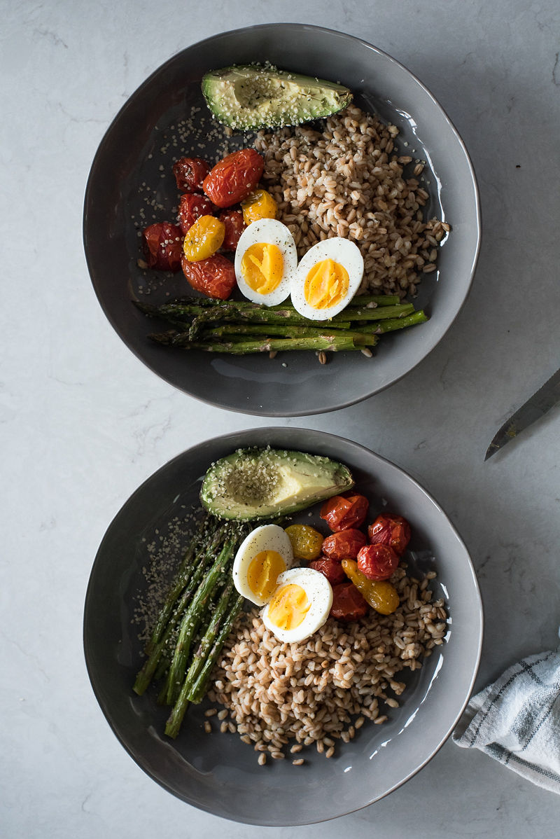 grain bowl for breakfast- farro, egg, asparagus, tomatoes, avocado and hemp seeds