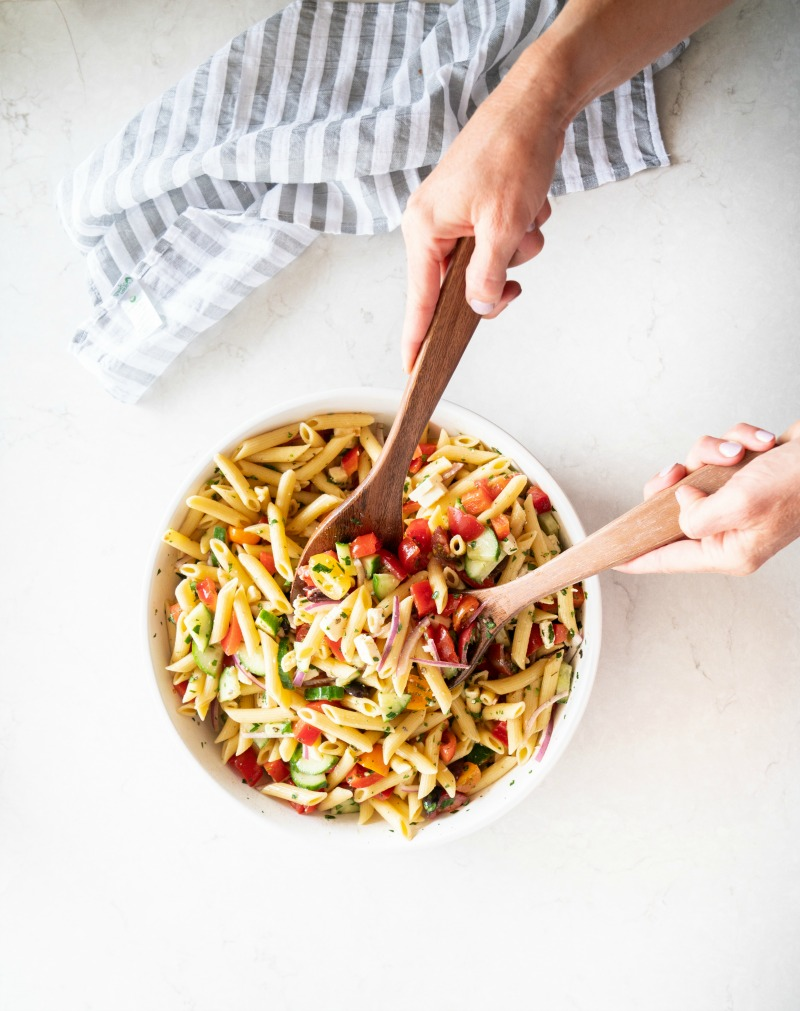 A gorgeous bowl full of a Greek inspired pasta salad. www.mountainmamacooks.com