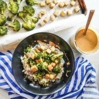 A bowl of stir fry with tofu, broccoli, steamed rice, and a delicious and easy peanut sauce.