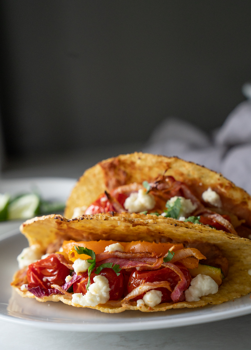 A plate of two tacos. Vegetarian. Veggies roasted on the Traeger grill. www.mountainmamacooks.com