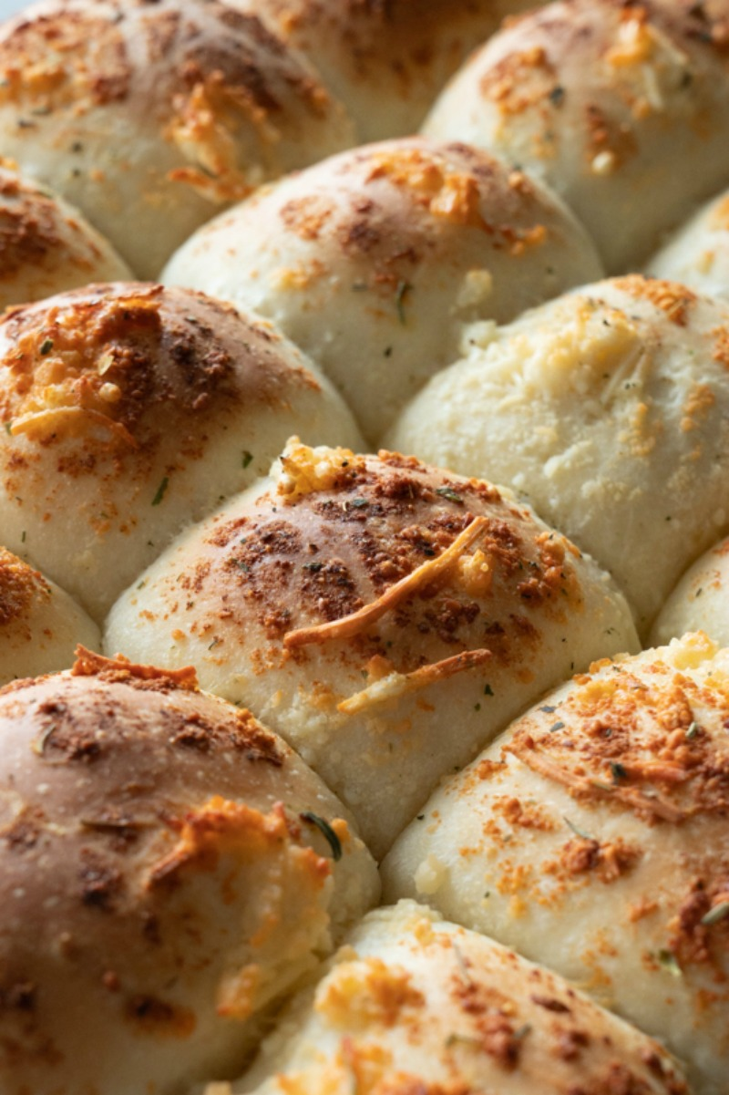 Easy Garlic Parmesan Rolls made with frozen rolls, melted butter, and parmesan cheese. These are a cinch and perfect for high altitude baking. www.mountainmamacooks.com