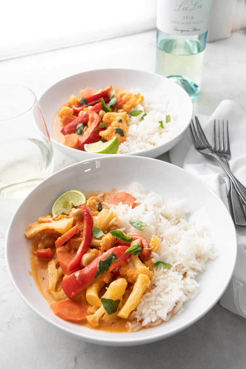 An easy weeknight dinner idea- Vegetarian Thai curry with cauliflower and chickpeas. From the cookbook, Two Peas and their Pod. www.mountainmamacooks.com