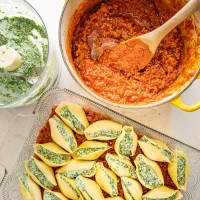 Shells stuffed with ricotta, spinach, fresh herbs and covered with a savory meat sauce. www.mountainmamacooks.com