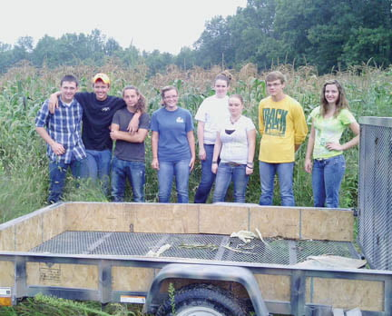 FFA members assist Chandler Piner (second from left) in harvesting 4,500 ears of sweet corn for the Greenbrier County schools.