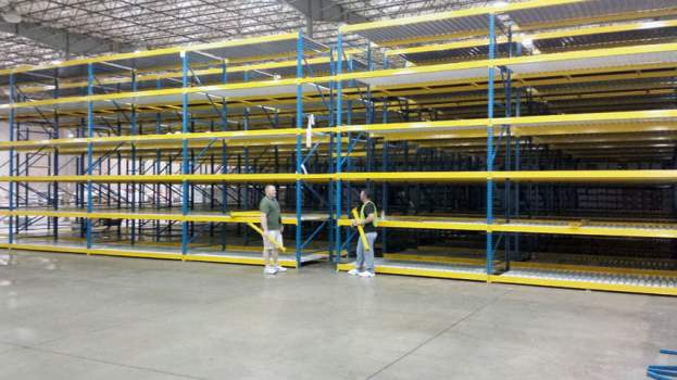 Gary Osborne and Darrell Osborne stand in front of newly-installed shelving at EvriChart's Low Moor facility.