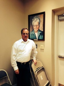 Doug Hylton stands by a portrait of Marie Leist in Ronceverte City Hall. The Leist Foundation is one of several organizations who have donated community development funds to the city.