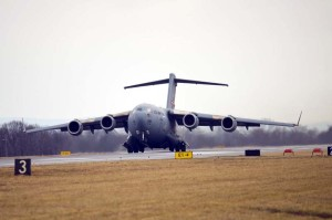 The front wheels of a C-17 Globemaster III lift off the runway at the 167th Airlift Wing, West Virginia Air National Guard base in Martinsburg, Dec. 18. This marked the first launch, a local training sortie, for the wing that is currently in conversion from the C-5 Galaxy to the C-17. The unit received its first C-17 aircraft Sept. 25. (Air National Guard photo by Master Sgt. Emily Beightol-Deyerle/released)