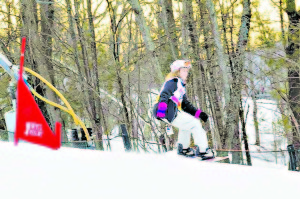 Lewisburg snowboarder Edie McMillion in completion this past winter. Next year she hopes to achieve her dream of competing nationally. She has qualified twice, but was unable to attend.
