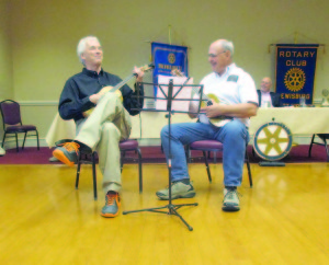 Bob DuCharme plays the ukulele with Lewisburg Rotarian Al Petrie at Monday's meeting. DuCharme also announced that a new ukulele club is meeting at Carnegie Hall, and anyone interested in joining in the fun and learning how to play the ukulele is welcome to attend. (David Esteppe story and photo)