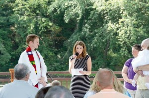Rev. Stephen Baldwin (left) and Elder Alyson Dotson (center) lead worship as Todd and Jill Trent (right) present their daughter Eden for baptism at a previous river worship service.