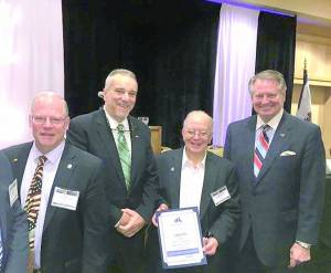 """Lewisburg was recognized as  an """"Amazing City"""" at the West Virginia Municipal League Winter Conference for their progressive governing to ensure equality and fair housing. John Manchester of Lewisburg (left), James C. Hunt, Amazing Cities founder/CEO, Serafino Nolletti of Logan and Steve Williams of Huntington received the 2015 West Virginia Amazing Cities awards at the West Virginia Municipal League Mid-Winter Meeting in Charleston on Monday."""