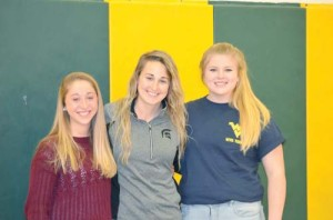 """Courtney Cole, head soccer coach at Greenbrier East High School, stands between two of her players who have signed for scholarships offered by West Virginia schools. Keirston Sutherland (left) will attend Concord. She played outside midfielder last season. """"She was really important, getting the ball to the outside, so we could get nice crosses in,"""" said Cole. Sutherland is the daughter of Michael and Tamyra Sutherland from Alderson. Makenna Blankenship (right) will play at WVU Tech. """"She was my one and only goalie,"""" stated her coach. """"Pretty much kept all the goals out. Only 12 goals were scored on her all season. She shut down a lot of teams."""" Blankenship is the daughter of Pete and Stephanie Blankenship from Lewisburg. (Photo by Mark Robinson)"""