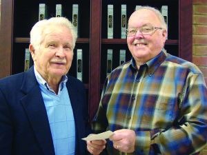 """Eugene """"Jeff"""" Jeffus presents a check to Greenbrier County Public Library trustee, Dave Nalker for 2016-2017 Operating Fundraising Campaign"""