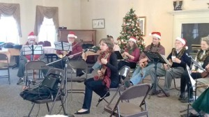 David Smith, Ron Magruder, Theresa Winstead, Robin Spence, Phil Hairless, Claude Jones and Robin Skillern performing as the Greater Greenbrier Valley Association of Ukulele Optimists at Greenbrier Manor on the group's spring tour of area retirement homes.