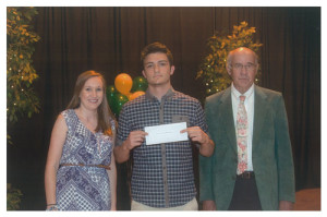 David Yarid Memorial Scholarship recipient from Greenbrier East High School Caleb Ward (center) receives his award from GEHS teacher Kristi Haddox and executive director of the foundation, Tim Holbrook.