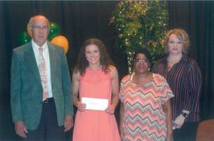 Kara Berry Memorial Scholarship recipient Kassey Wagner (second from left) receives her award from Tim Holbrook, executive director of the Greenbrier County Schools Foundation; Tracy Berry, Berry's mother; and Lee Anne Hobbs, cheerleading coach at Greenbrier East High School.