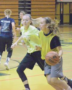 Abbie Bartenslager handles the ball on the perimeter, guarded by Haley McClure. The Greenbrier East girls basketball season kicked off Monday, Nov. 7, with tryouts. The first game is Nov. 29. (Mark Robinson photo)
