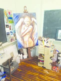 (Photo by Sarah Richardson) An unfinished painting by local artist Elizabeth Goertz stands in the corner of her studio.