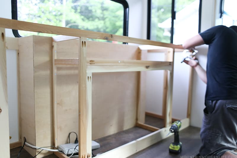 Are you considering tweaking the floor plan of your motorhome? Come see how we are installing a TV lift & electric fireplace inside a custom cabinet of our RV! MountainModernLife.com
