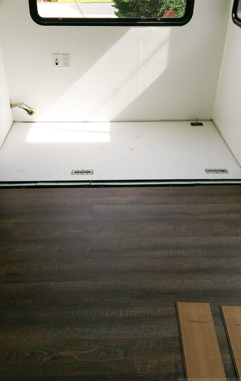 Planning to replace the flooring in your RV or camper? After some trial and error we are sharing some tips to replace the flooring Inside a RV slide out | MountainModernLife.com
