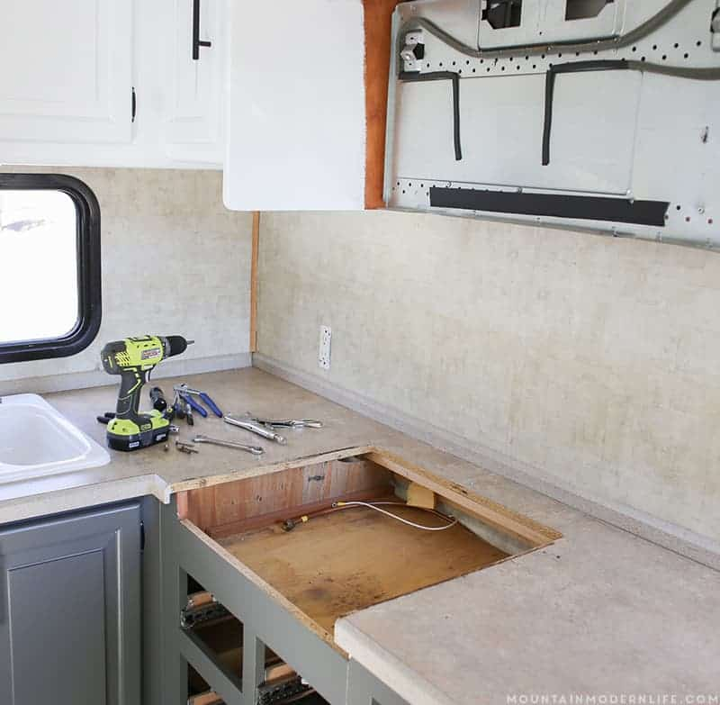 See how easy it is to remove your RV Kitchen Stove, in case you need to set it aside, clean it or replace it. MountainModernLife.com