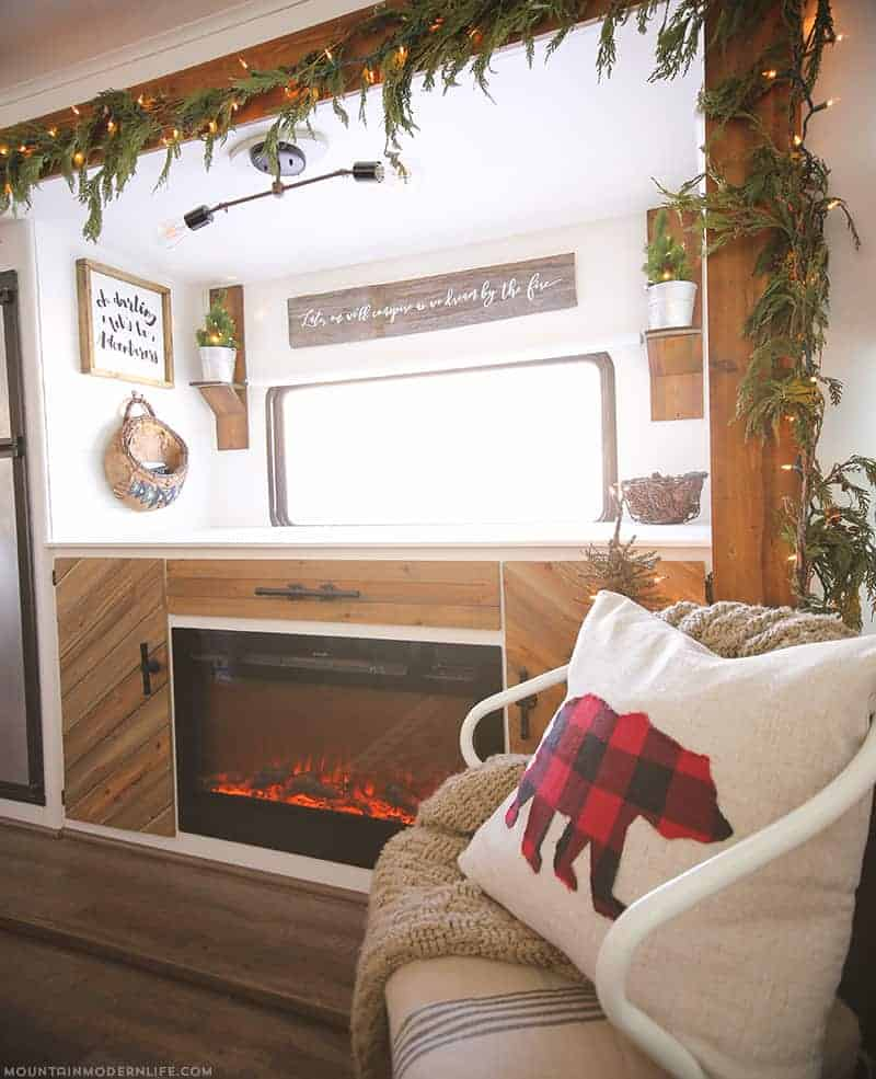Are you looking for a creative way to hide your tv when it's not in use? We dive into how we hid our tv and added a cozy vibe with our electric fireplace.
