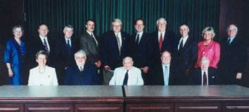 Members of the Board of Trustees were formally photographed at their June 2001 annual meeting. Seated are Dawneda Williams, Judge Birg Sergent, Judge Glen Williams, Judge Bob Williams, and Woodrow McGlothlin. Standing are Ann Gillenwater, Joe Wolfe, Roger Rife, Jack Davidson, Eddie Lindsay, ASL Dean Tony Sutin, Roger Powers, Frank Kilgore, Sandra McGlothlin, and Lu Ellsworth. Not pictured are Judge N.E. Persin, Gerald Gray, Charlie Ellis, U.S. Senator George Allen, and Mark Warner.