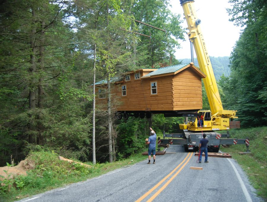 How we are different mountain recreation log cabins for Least expensive prefab homes