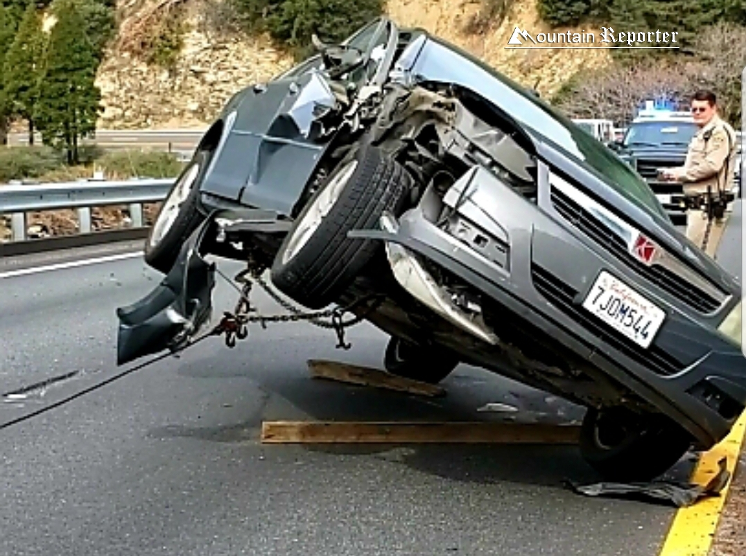 Saturn Tangles with Dump Truck on Highway 18, Rollover