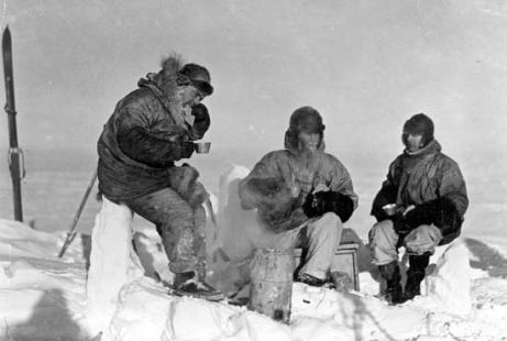 Richard E. Byrd, left, sits with fellow explorers at the Little America base on the Ross Ice Shelf, in about 1930. The Granger Collection, New York