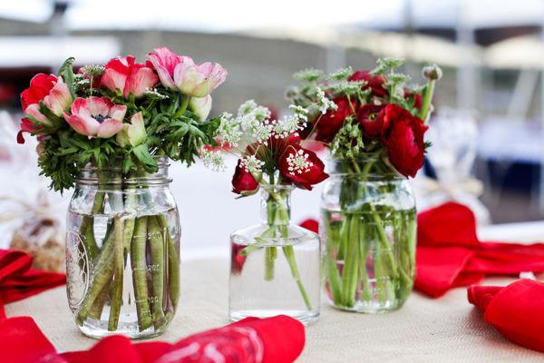 red flowers in rustic mason jars
