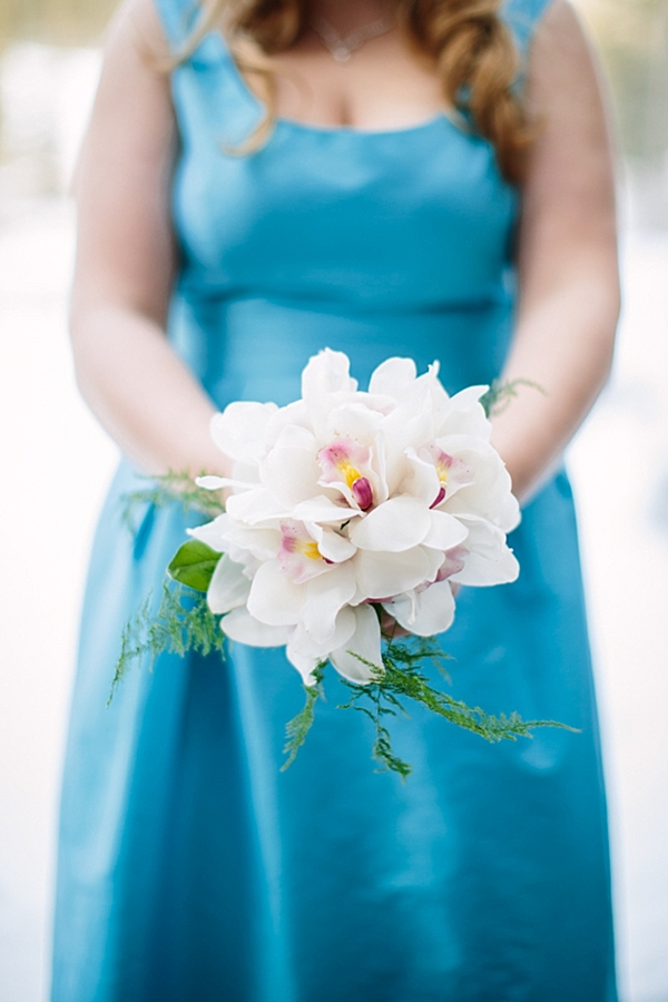 blue bridesmaid dress with white orchids