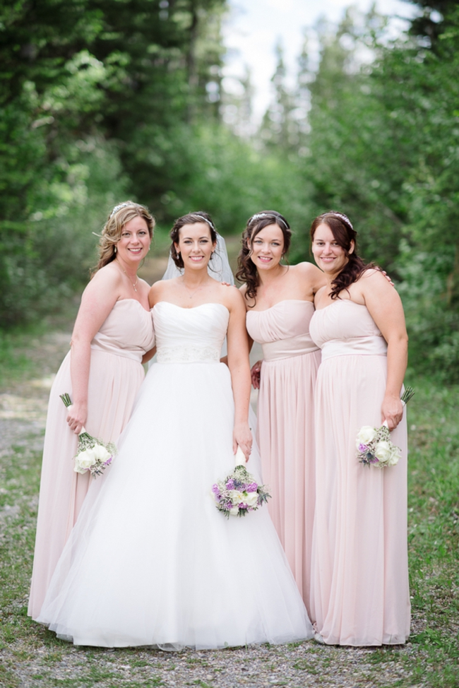 bridesmaids in pale pink gowns