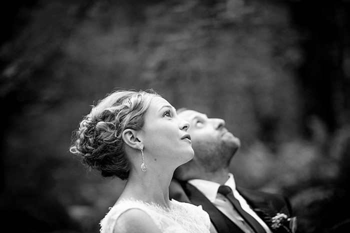 bride and groom look up