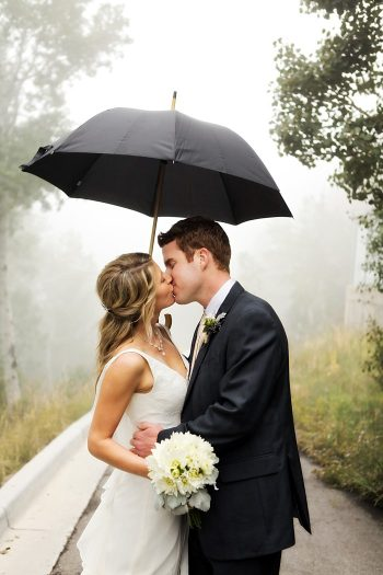 bride and groom under an umbrella | Snowbird Utah Wedding Logan Walker Photography