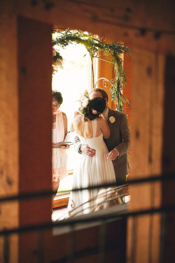 13 Ceremony Kiss Sandpoint Idaho Mountain Wedding Amy Galbraith Photography   Via MountainsideBride.com