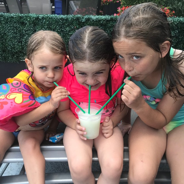 Sisters sipping frozen lemonade at DC hotel pool via Ashley Stevens - Mountains Unmoved